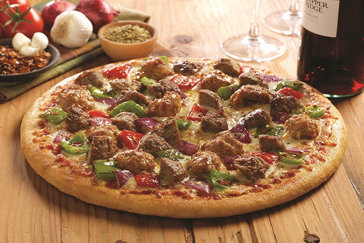 Meats and Veggies in a Pizza